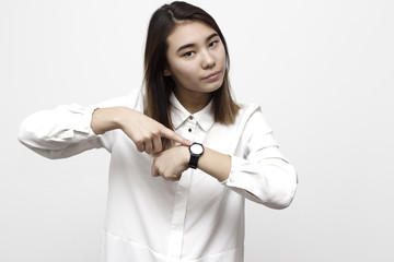 Portrait of pretty woman with wrist watch showing and remiding about time. Hurry up concept
