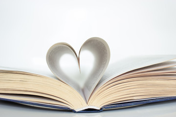 Book with love symbol isolated on white background