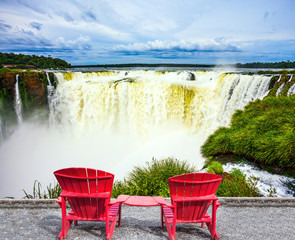 Two chaise lounges set at waterfalls