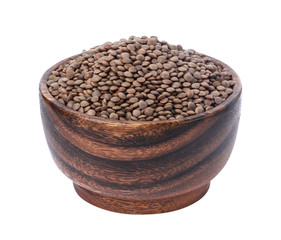 Lentils in wooden bowl isolated on white background