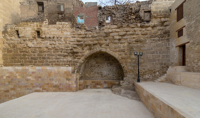 Courtyard of Tekkeyet Al-Bustami with big embedded niche mediating stone bricks wall, Cairo, Egypt