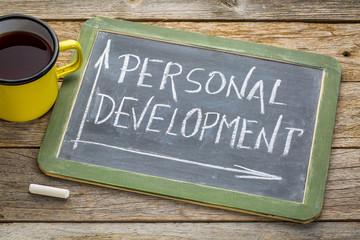 personal development in white chalk on blackboard