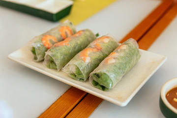 Vietnamese Fresh Spring Rolls including lettuce and boiled shrimp at the restaurant in Hanoi, Vietnam.