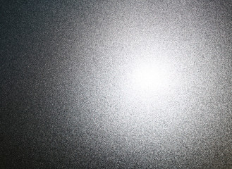 Silvery metal surface with glare
