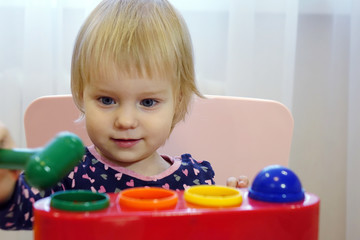 Cute little girl playing with blocks toy in kindergarten. The children are playing. Children in the garden.