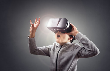 Boy experiencing using a virtual reality headset
