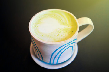 Cup of Matcha latte Green Tea with heart