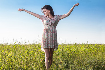 Young beautiful woman in the fields