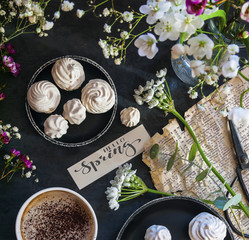 Composition with flowers, coffee and marshmallow cookies. The conception of wedding or birthday