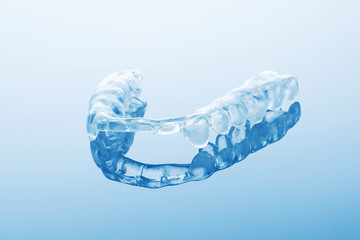 night dental guard by bruxism on blue background