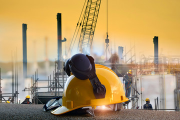 Double exposure of Standard construction safety and construction site background . Safety  concept .