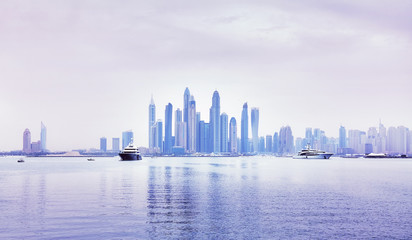 Dubai waterfront skyline, color toning applied, United Arab Emirates.