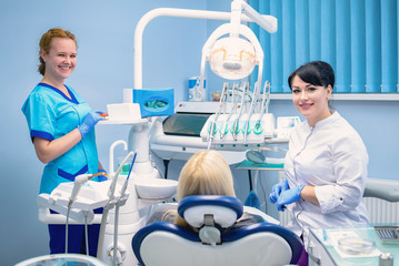 The dentist treats the patient in the clinic