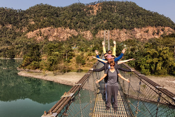 Group of Tourists on a Suspension Bridge, Nepal