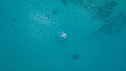 Aerial view of sculler in open water.
