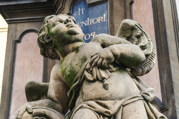 Decore of St.Nicholas Church. Beautiful angel child statue and looking up. From Baroque town of Prague, Czech Republic
