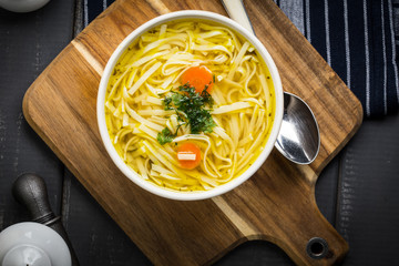 Tasty meat broth with noodles.