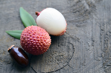 Fresh organic lychee fruits on a rustic wooden background.Lychees.Raw diet or vegan food concept.Selective focus.