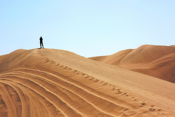 The man in Huacachina desert dunes