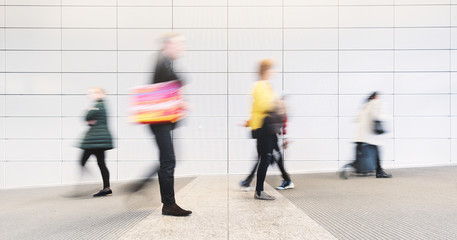 blurred people in a corridor