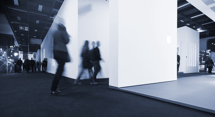 blurred people in a corridor