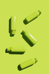 Bottles arranged randomly on green background