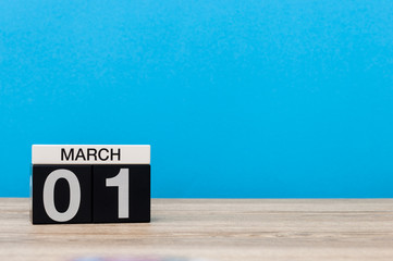March 1st. Day 1 of march month, calendar on light blue background. Spring time, empty space for text, mockup