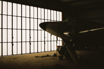 Airplane in empty hangar