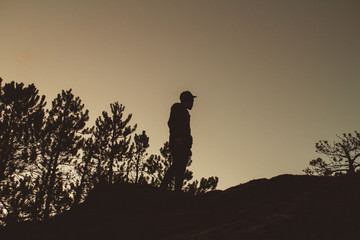 Silhouette of man outdoors at night