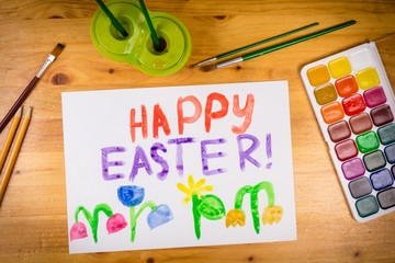 easter greeting card with paintbrush and palette  at the table