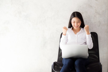 Beautiful asian young woman excited and glad of success with laptop, girl working coffee shop on cement background, career freelance business concept.