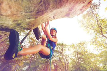Rock climber training outdoors at sunny day Wall mural