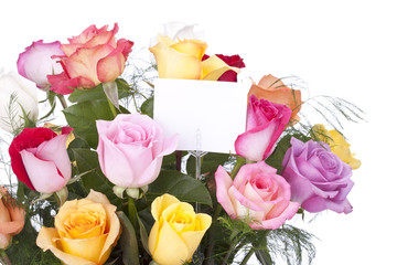 Multi colored bouquet of roses in a vase isolated on white