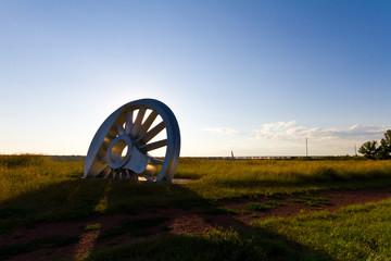 Steel train wheel on a field