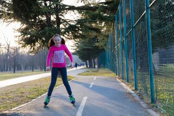 Little girl roller skating