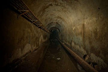 Underground sewer tunnel under Sevastopol, Crimea. Flooded sewerage drainage tunnel