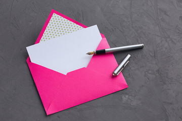 Pink envelope on stone background
