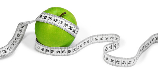 Measuring Tape And Apple Diet Concept