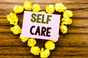 Word, writing Self Care. Business concept for Taking caring for own Health written on sticky note paper on wooden background.