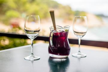 Jug with Sangriya and two glasses on the table
