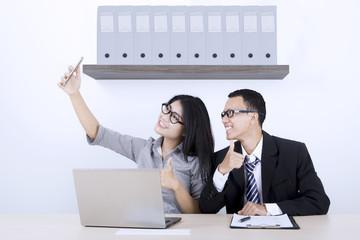 Business team taking selfie photo
