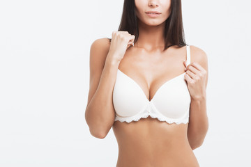 Girl with gorgeous Breasts on a white background.