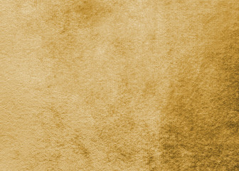Gold velvet background or golden yellow velour flannel texture made of cotton or wool with soft...