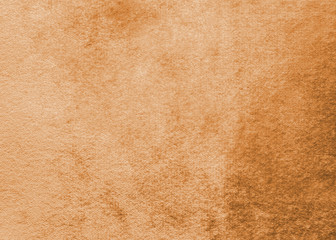 Copper gold velvet background or orange golden velour flannel texture made of cotton or wool with soft fluffy velvety fabric cloth metallic color material