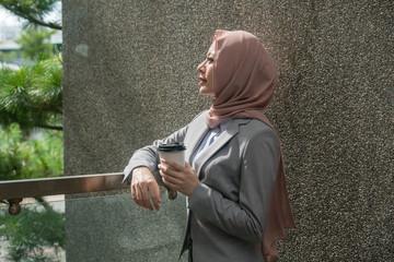 leisurely pretty female muslim office worker
