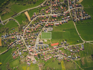 arial view of town and green soccer stadium in Germany