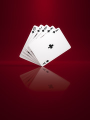 some poker cards on a background red