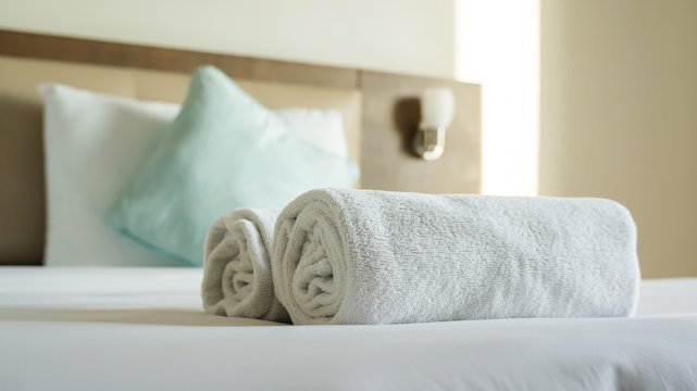 White towel shampoo and soap on a bed.