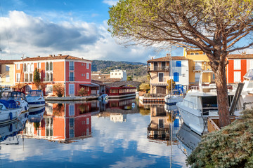 Colorful city on the water, Port of Grimaud, Côte d'Azur, France, Provence, houses and boats. Beautiful city landscape