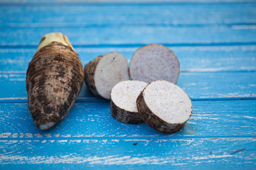 Group of Taro Root on wooden Background